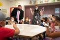 Secretary Cardona with students in classroom in masks