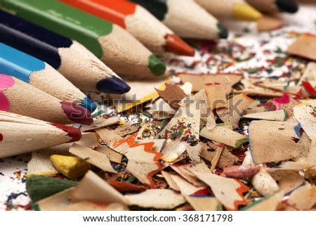 Creative mess on the table cartoonist. Colorful wooden pencils.