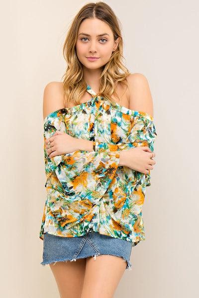 Floral print open-shoulder top featuring halter neckline