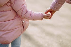 Stress and Recovery from Addiction Close up of young girl holding someone's hand