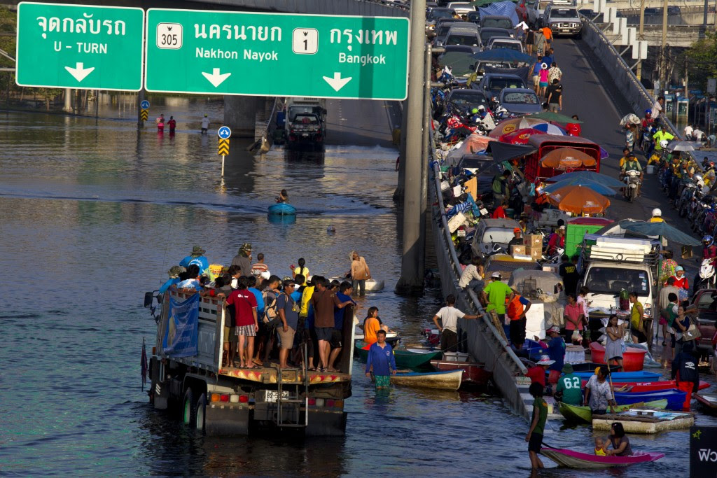 Bangkok Floods Continue To Threaten People and Economy
