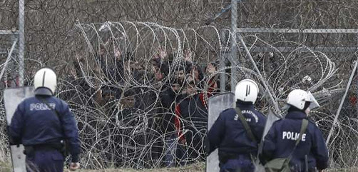 Greek security forces intervene in asylum seekers, who attempt to cross the barbed fence at the closed-off Greek-Turkish border, in Kastanies, Greece on March 04, 2020. - ALLOW IMAGES