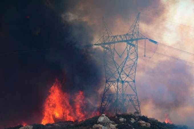 Power lines lie in the path of an approaching brush fire along Japatul Road in Jamul, Calif., on Sept. 6. (Photo by Sandy Huffaker/AFP via Getty Images)