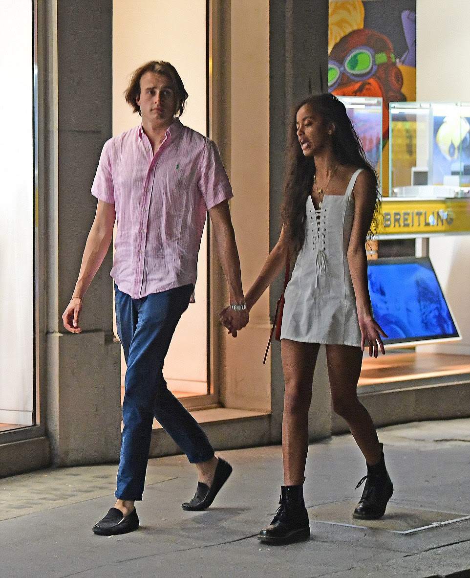 Another PDA display: During another trip, Malia held hands with boyfriend Rory Farquharson as they walked around Mayfair, London last month