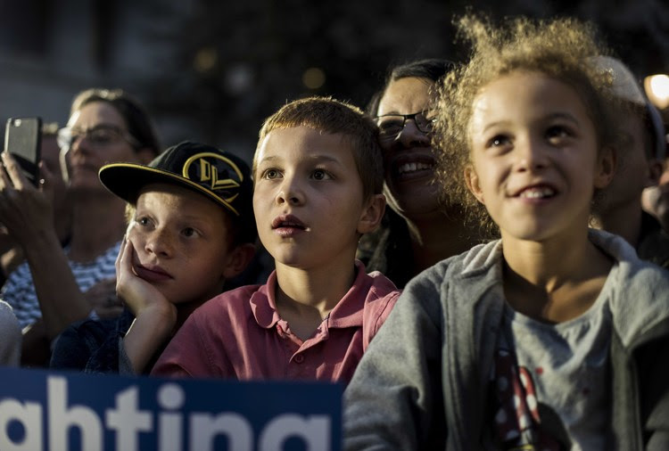 Supporters watch Hillary speak at City Hall park in Philadelphia last night. (Photo by Melina Mara/The Washington Post)</p>