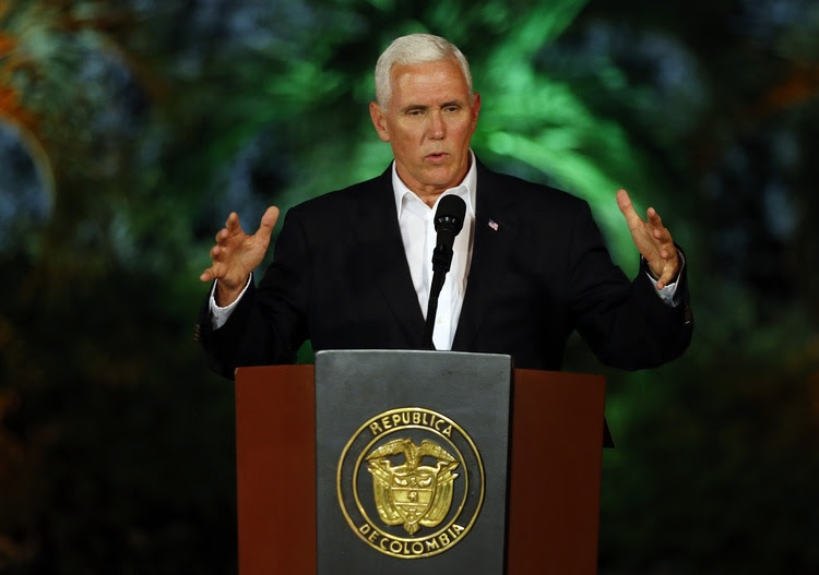 Mike Pence speaks last night during a joint press conference with Colombian President Juan Manuel Santos in Cartagena. (Fernando Vergara/AP)