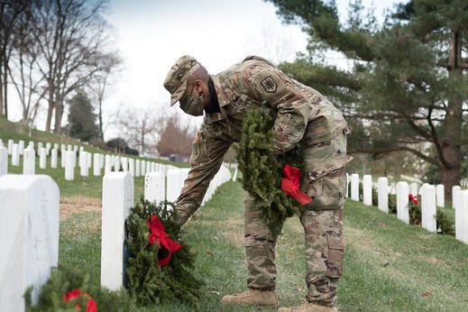 Solider Places Wreath