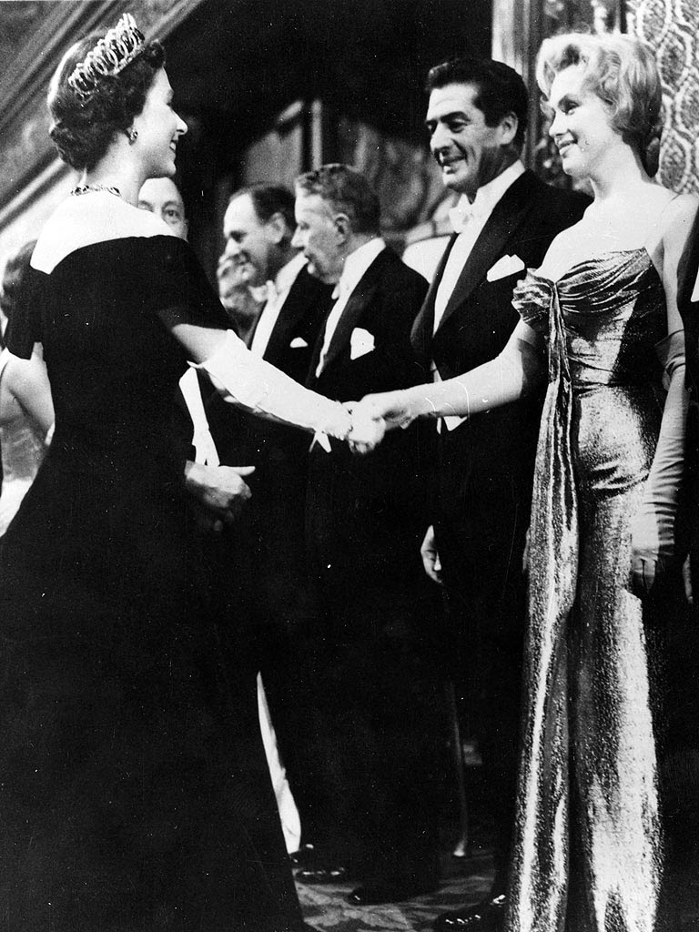 Marilyn                                                          Monroe and                                                          Queen                                                          Elizabeth                                                           (both 30 at                                                          the time) meet                                                          at a movie                                                          premier in                                                          London.                                                          October 1956