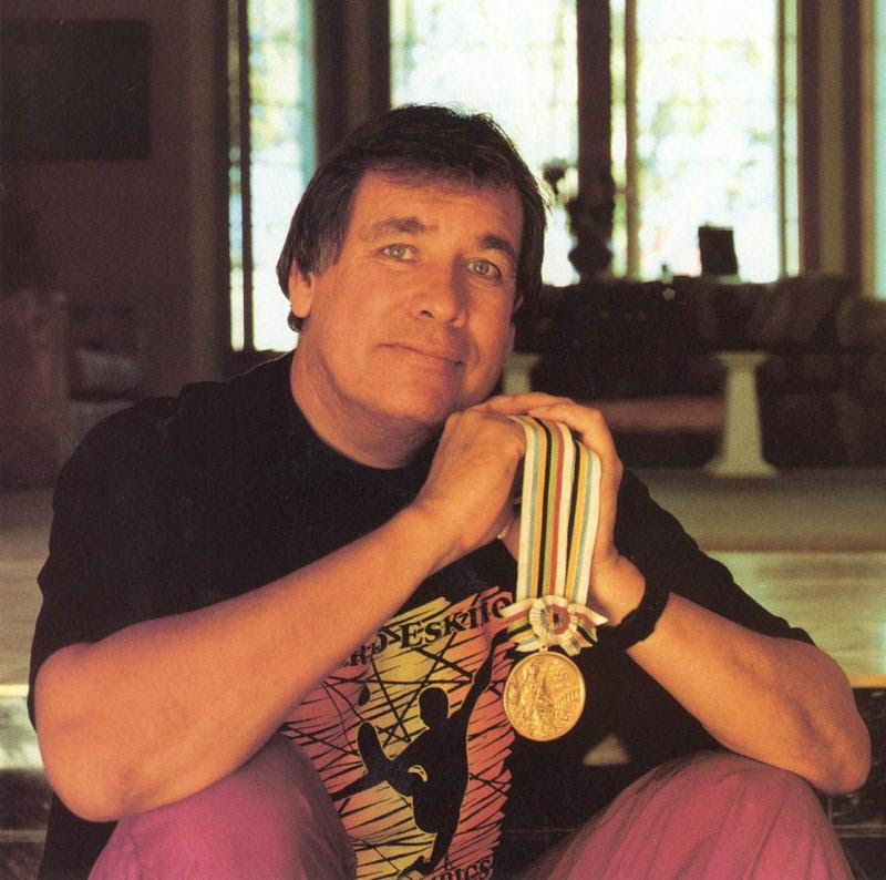 Billy Mills with Gold Medal
