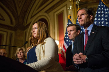 Tina Meins, whose father was killed in the mass shooting in San Bernardino, Calif., at a news conference on gun violence at the Capitol on Thursday. Beside her were Senators Christopher J. Murphy, center, and Richard Blumenthal, both Democrats of Connecticut.