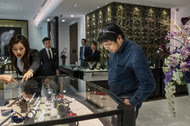 U Thiri Thein Than, a 40-year-old automotive engineer and watch enthusiast, examines some of the timepieces in the Franck Muller watch boutique in Yangon, Myanmar's first monobrand watch store.