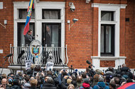 Julian Assange, founder of WikiLeaks, emerging onto the balcony of the Ecuadorean Embassy in London to make a statement in February.
