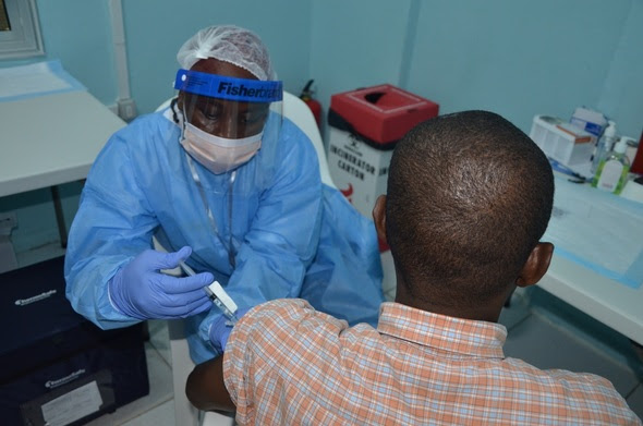 study volunteer receives an injection