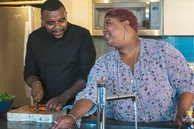 A Veteran and partner cooking healthy food together
