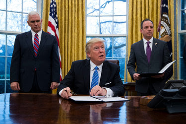 President Trump signing a memorandum in the Oval Office on Monday.