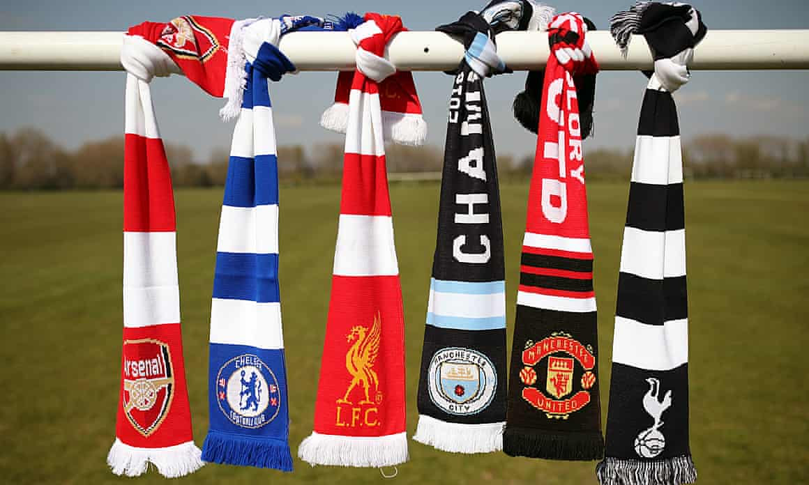 The six red-faced English clubs' scarves tied to a crossbar on Hackney Marshes, earlier.