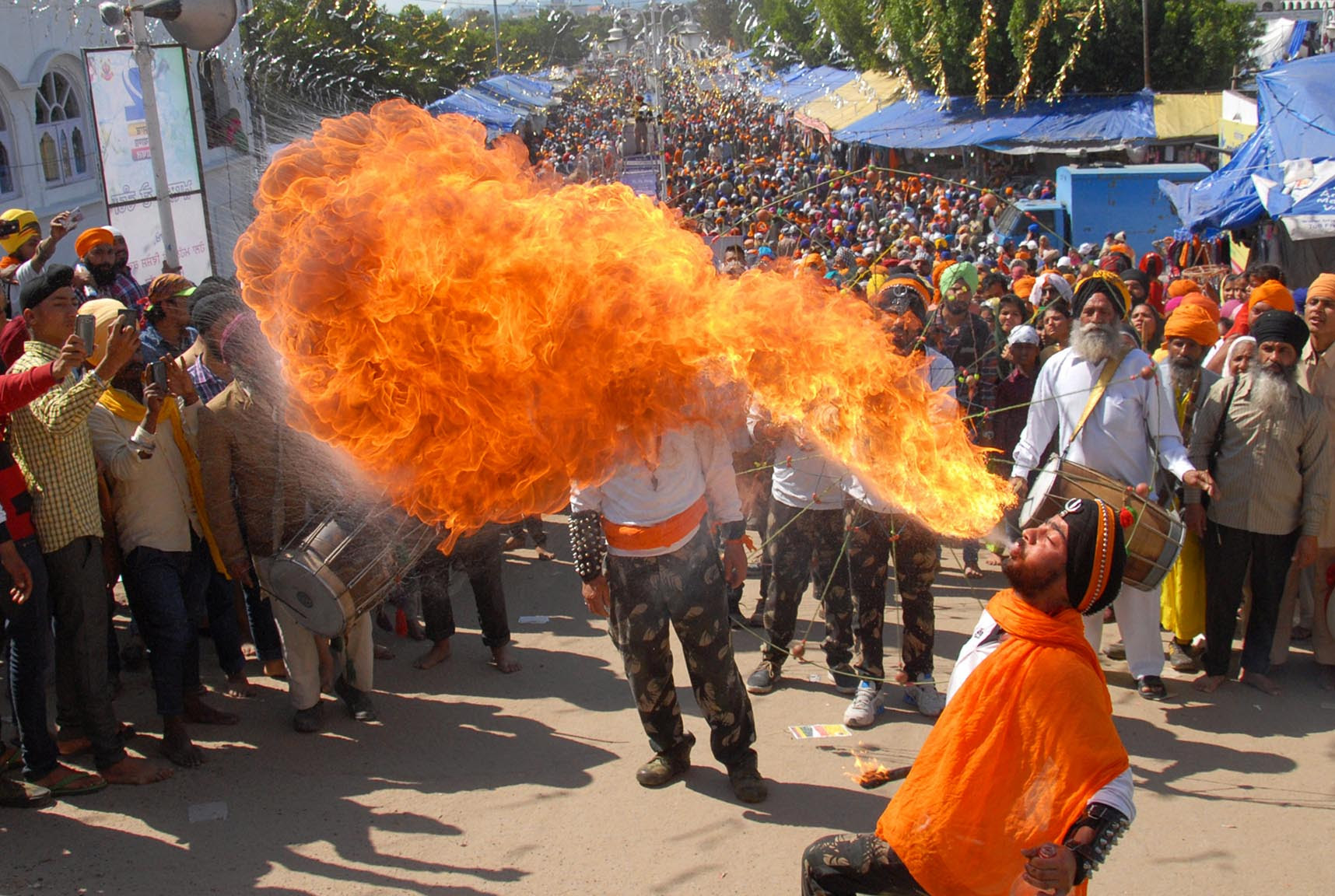An Indian Sikh performs fire-breathing