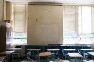 A classroom at Warren Harding High School in Bridgeport, Conn., where 1,100 students make do with crumbling walls and peeling paint. The school's graduation rate is a dismal 54 percent.