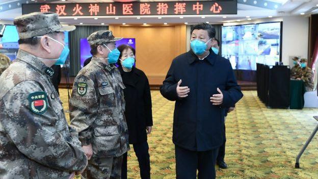 Presidente da China, Xi Jinping, e funcionários do governo