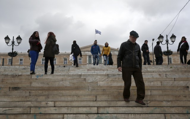 People make their way at central Syntagma square in front of the parliament in Athens