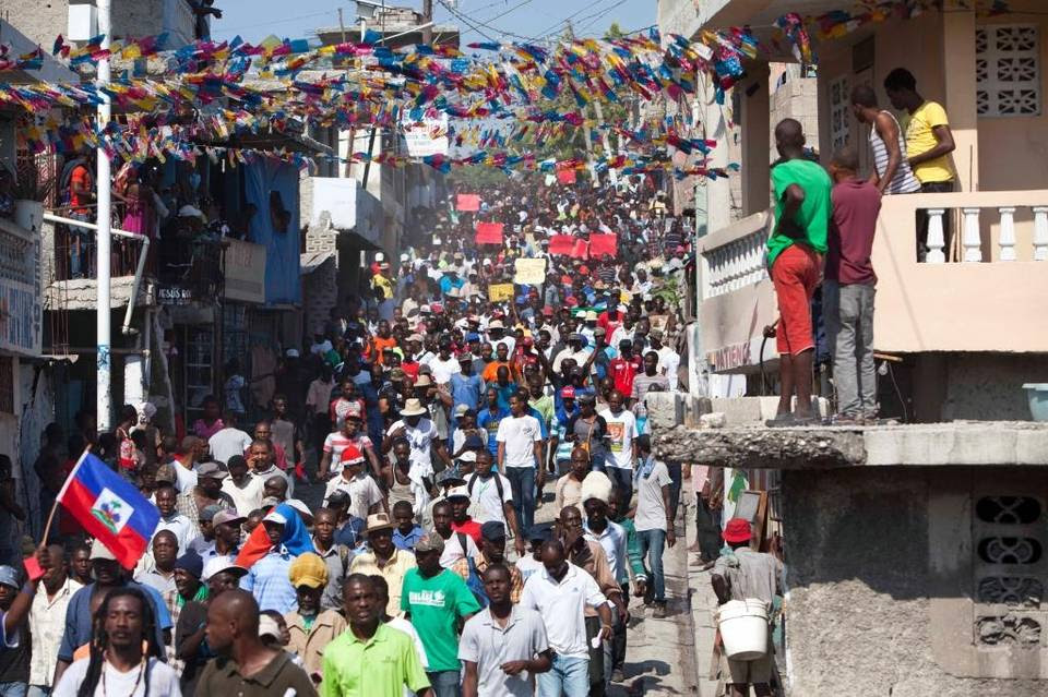 In this Monday, Jan. 18, 2016 photo, protesters chant anti-government slogans during a protest demanding the cancellation of the upcoming elections, in Port-au-Prince, Haiti. Just two days before the presidential and legislative runoffs, the spokesman for Haiti's electoral council said Friday, Jan. 22, 2016, that the council has agreed to postpone for a second time.