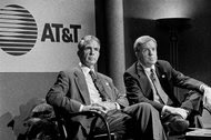 Robert E. Allen, left, and James L. Barksdale announcing the merger of AT&T with McCaw Cellular Communications in 1994.