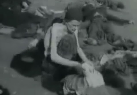 Here                             is a German prisoner of war topless in                             summer 1945 searching clothes on the ground,                             and in the background there is a dead German                             detainee in a gray uniform (3min. 7sec.)