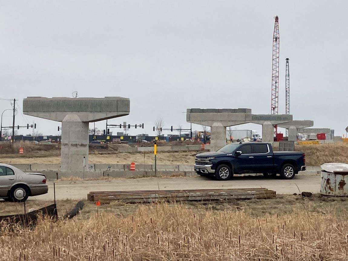 LRT bridge at Highway 212 and Shady Oak Road: pier work is ongoing, followed by span placement and deck work.