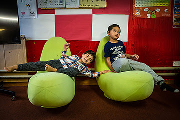Two young children sitting on beanbags