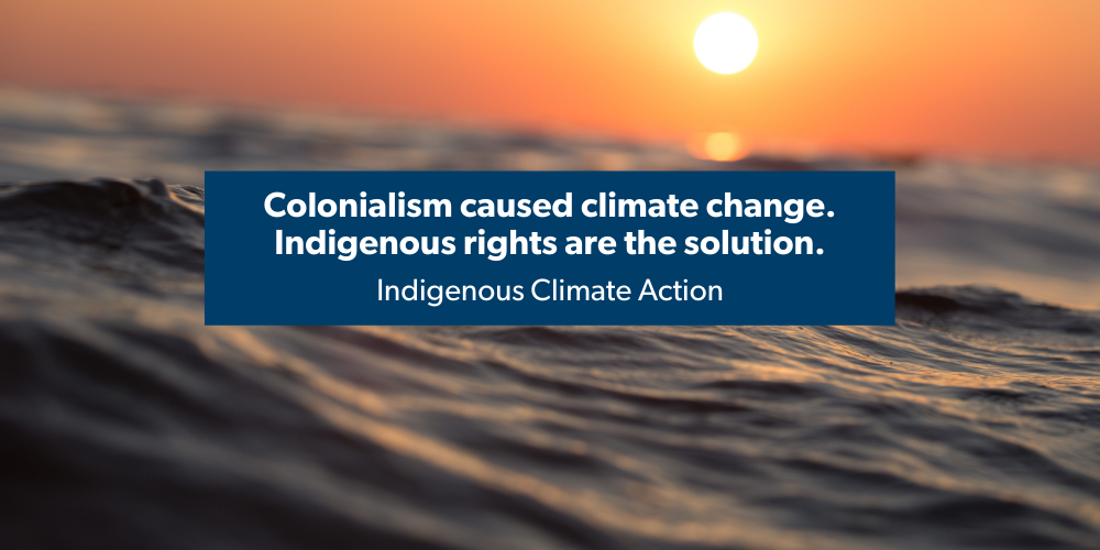 """Water with shining sun in distance with text: """"Colonialism caused climate change. Indigenous rights are the solution."""""""