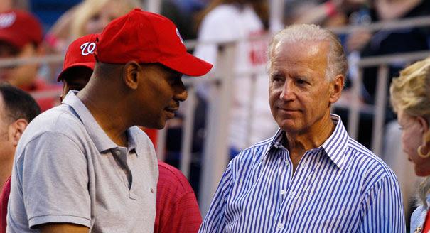 Joe Biden looking at red cap
