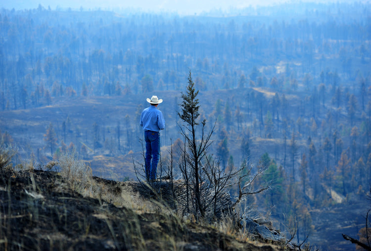 Tim Weyer tours his ranch, which was consumed by wildfires last month, in Sand Springs, Mont. (Rion Sanders/The Great Falls Tribune via AP)