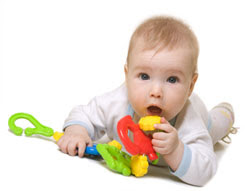 baby on floor with toy