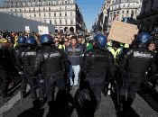 """French anti-riot police form a line ahead of """"yellow vests"""" protesters in Paris, France, February 23, 2019."""