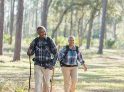 Photo of an elderly couple walking on a nature trail