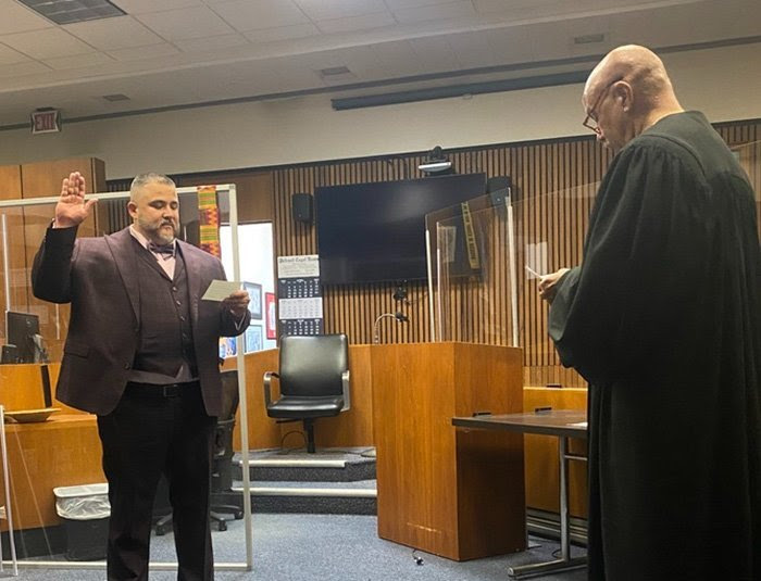 A lawyer being sworn in by a judge