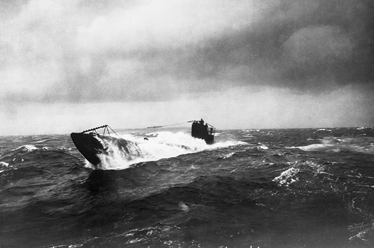 German U-boat rises breaks through the ocean surface.