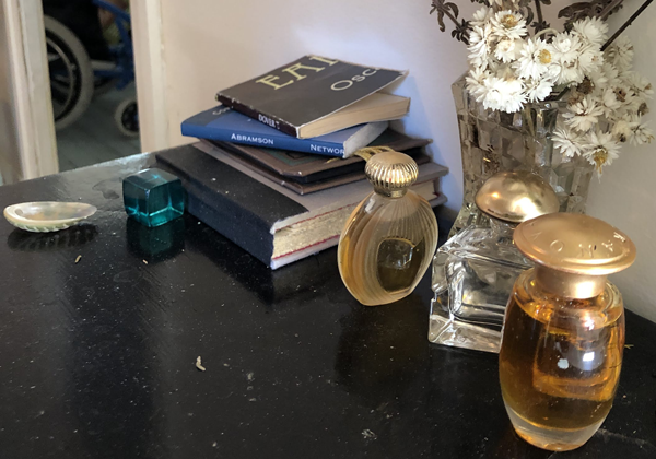 Books and Perfume Bottles on a desk