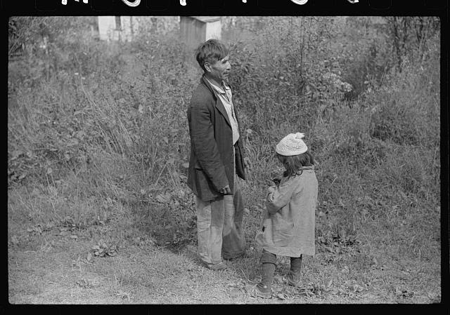 "[Untitled photo, possibly related to: Mexican miner and child, Bertha Hill, West Virginia. Many Mexicans and Negroes were brought into Scotts Run around 1926 to break the strike. Now about one fourth of all mines employ any at all and these, only very small percent and ""only the cream."" They are generally accepted by other folks and there is a good deal of mixing and intermarrying]"
