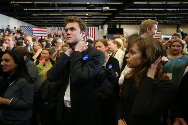 Blake Cooper Griffin, center, a volunteer from Los Angeles, watched the results come in at Hillary Clinton's rally in Des Moines.