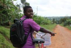 Nawalat stands with her bicycle, ready for school