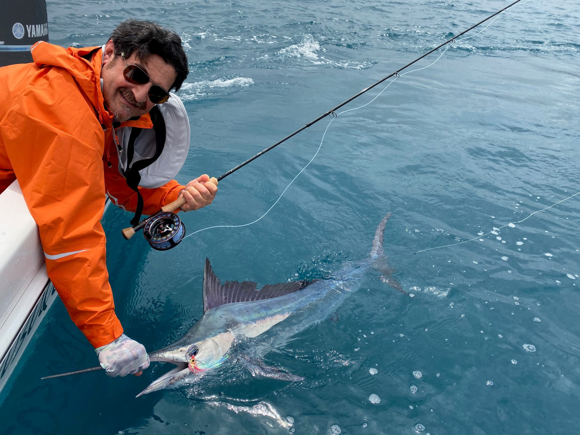 Nick with a black marlin caught on fly tackle.