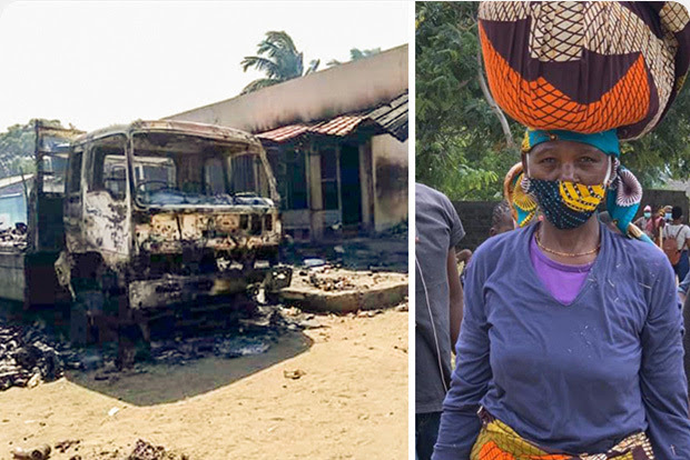 Burnt out truck; woman carrying items on her head