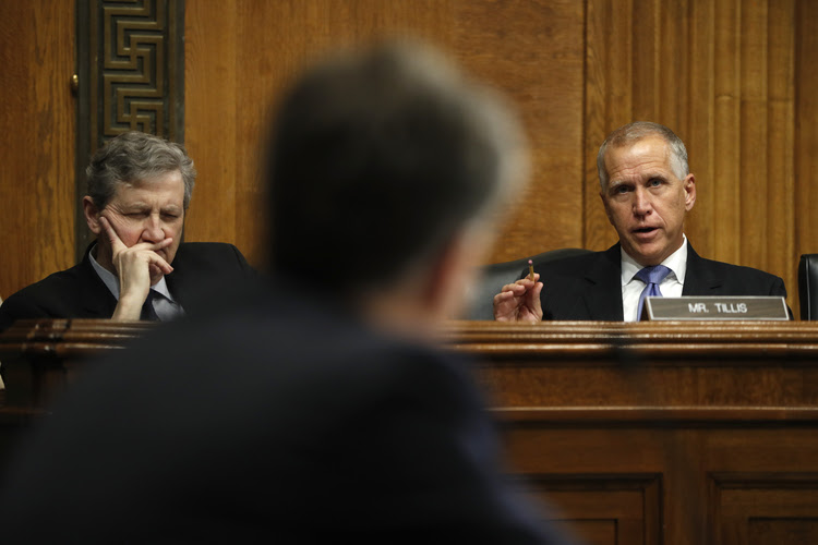 Sen. Thom Tillis (R-N.C.), right, questions newly confirmed FBI Director Christopher Wray during his confirmation hearing last month. (Pablo Martinez Monsivais/AP)