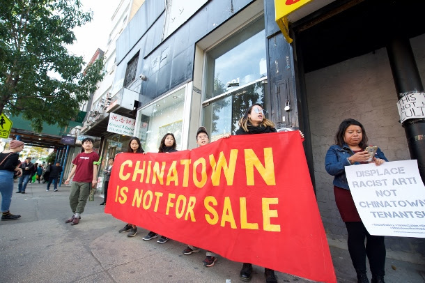 Residents and advocates protest gentrification of Chinatown outside the James Cohan Gallery.