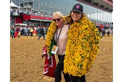 (L-R): Kim Carroll and Samantha Bussanich head back to the barn after War of Will's win in the Preakness Stakes at Pimlico Race Course