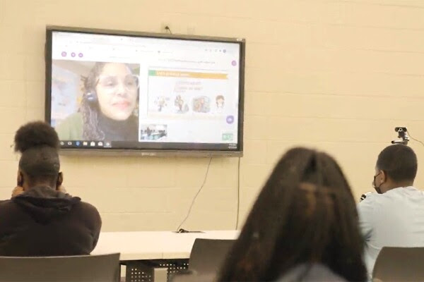 Teresa Vazquez, a teacher in Fort Wayne, Ind., remotely teaches a Spanish 1 class to students at Monroe High School in Albany, Ga.