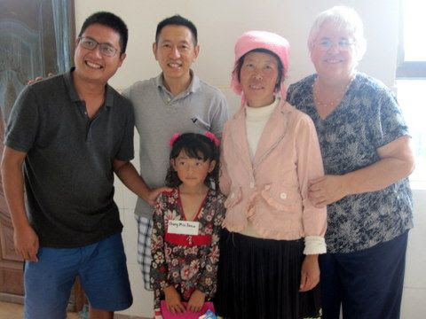 Matthew Liu, Eric Zhang and Betty Cutts with  Zhang Minjuan and her mother.