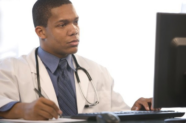 Male doctor at computer