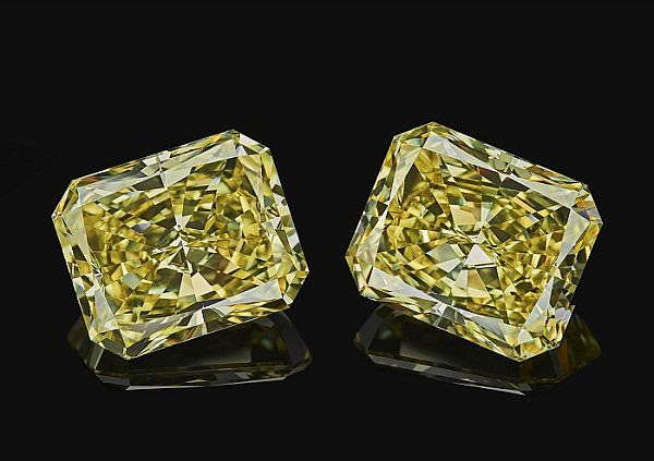 Twin 10-carat fancy intense yellow radiant diamonds, from Alrosa Russian mining firm